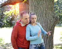 Man and  woman near an oak in summer  day something was seen aside and looked scaredly and with astonishment Royalty Free Stock Images