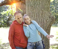 Man and  woman near an oak in summer  day something was seen aside and looked scaredly and with astonishment Stock Photos