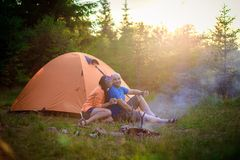 A man and a woman near the tent Royalty Free Stock Image