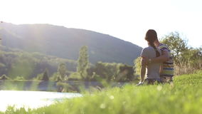Man and woman near the water on the river bank. stock footage
