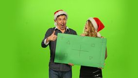 Man and woman: new year's eve. green screen, blank stock video footage