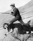 Man and woman next to a dry lake with fishing rod Stock Photography
