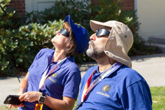 Man and woman observe eclipse with safety glasses. Two eclipse observers with protective solar eclipse glasses in Salem Oregon for the total solar eclipse Aug 21 Stock Image