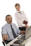 A man and a woman in office. Are solving a problem. Boss is showing something to his secretary Stock Photography