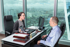 Man and woman in the office Royalty Free Stock Image