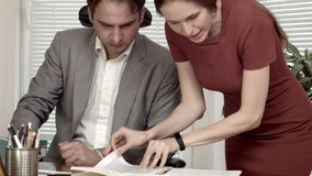 Man and woman at the office contract discussion.  stock footage
