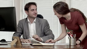 Man and woman at the office contract discussion dolly out.  stock footage