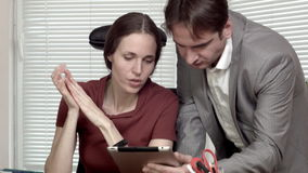 Man and woman at the office data on tablet discussion.  stock video