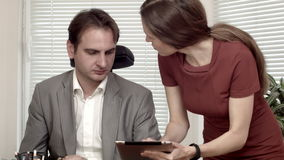 Man and woman at the office data on tablet discussion.  stock video footage