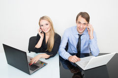 Man and woman in the office for notebooks Royalty Free Stock Images