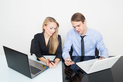 Man and woman in the office for notebooks Stock Photo