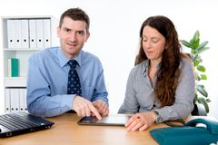 Man and woman in the office Stock Images