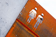 Man and woman old rusty metal sign Royalty Free Stock Image