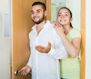 Man and woman opening the door to the apartment Stock Photo