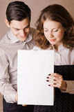 Man and woman opening white box Stock Images