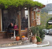 Man And Woman In Outdoor Restaurant Crete Greece Stock Photography