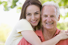 Man and woman outdoors embracing and smiling Royalty Free Stock Photos