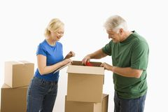 Man and woman packing. Stock Photos