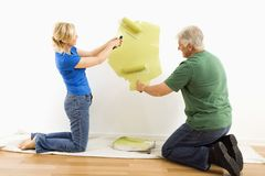 Man and woman painting wall. Royalty Free Stock Image