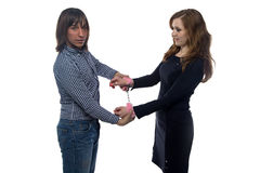 Man and woman with pair of fluffy handcuffs Royalty Free Stock Image