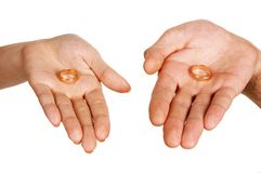 Man woman palms holding rings Royalty Free Stock Images