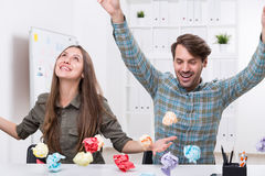 Man and woman with paper balls. Royalty Free Stock Photography