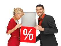 Man and woman with percent sign Stock Photography
