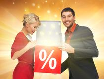 Man and woman with percent sign Royalty Free Stock Photography