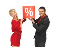Man and woman with percent sign Royalty Free Stock Images