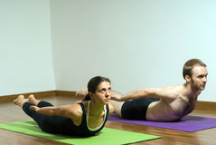 Man and Woman Performing Yoga - Horizontal Stock Photography
