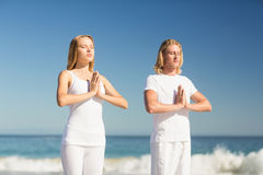 Man and woman performing yoga Stock Photo
