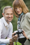 Man and woman with photo camera Royalty Free Stock Image