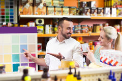 Man and woman picking paint color Stock Photo