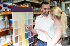 Man and woman picking paint color Royalty Free Stock Image
