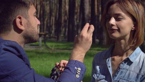 Man and woman on a picnic in park. stock footage