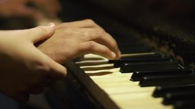 Man and woman play on the piano stock video footage