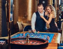 A man and woman play roulette. Royalty Free Stock Image