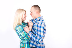 Man and woman playfully quarrel in the studio. royalty free stock image