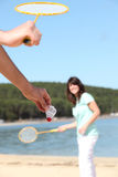Man and woman playing badminton. On the beach Royalty Free Stock Photography