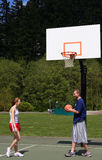 Man and woman playing basketball Stock Images