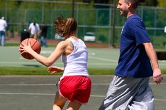 Man and woman playing basketball Royalty Free Stock Photo