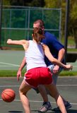 Man and woman playing basketball Royalty Free Stock Photos