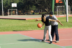 Man and Woman Playing Basketball - Horizontal Royalty Free Stock Image