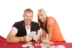 Man and woman playing cards he is happy Stock Photo