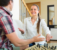 Man and woman playing chess royalty free stock image