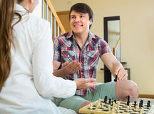 Man and woman playing chess Stock Photos