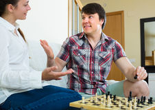 Man and woman playing chess Stock Images