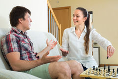 Man and woman playing chess Stock Photo