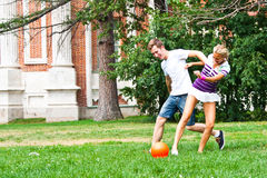 Man and woman playing football Royalty Free Stock Image