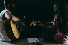 Man and Woman Playing Guitar stock images